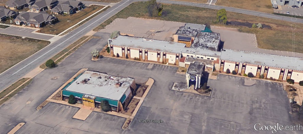 From Google Earth, a view of the restaurant and hotel on the subject property. If a house this blighted had been owned by a poor inner-city resident, the city would have long ago condemned and demolished the building, at the homeowner's expense.