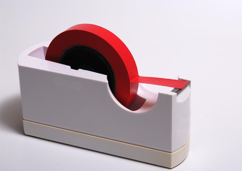 Red tape dispenser